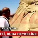 İsyan etti, Buda heykeline böyle saldırdı!