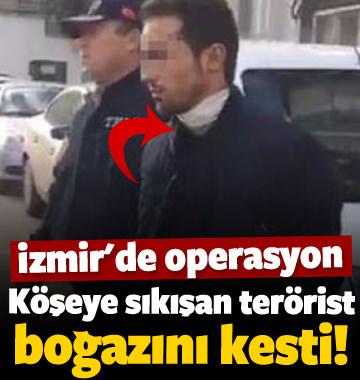 Polisi gören PKK'lı terörist boğazını kesti!